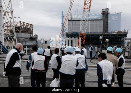 January 22, 2020, Okuma, Fukushima, Japan: Journalists inspect Unit 1 (L) and Unit 2 (R) reactor houses during their inspection tour at tsunami-devastated Tokyo Electric Power Company (TEPCO) Fukushima Daiichi Nuclear Power Plant in Okuma town, Fukushima Prefecture, 22 January 2020. The storage tanks including water processed in the ALPS will be full around summer of 2022, TEPCO has told. Japanese government need to decide soon how manage the processed water still including tritium.  (Credit Image: © Kimimasa Mayama/POOL via ZUMA Wire) - Stock Photo
