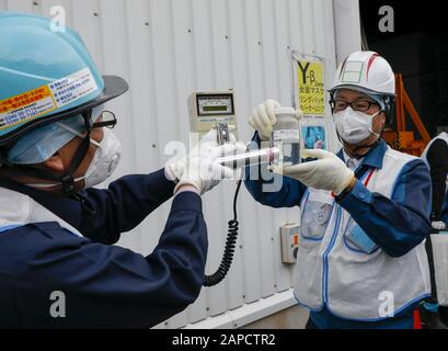 January 22, 2020, Okuma, Fukushima, Japan: Workers of  Tokyo Electric Power Company (TEPCO) Fukushima Daiichi Nuclear Power Plant demonstrate to measure radiation of water processed in ALPS(Multi-nuclide retrieval equipment) II in front of the ALPS II building at the tsunami-devastated nuclear power plant in Okuma town, Fukushima Prefecture, 22 January 2020. The storage tanks including water processed in the ALPS will be full around summer of 2022, TEPCO has told. Japanese government will need to decide soon how manage the processed water still including tritium.  (Credit Image: © Kimimasa May - Stock Photo