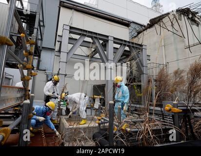 Okuma, Fukushima, Japan. 22nd Jan, 2020. Workers checks drain at Unit 4 building of tsunami-devastated Tokyo Electric Power Company (TEPCO) Fukushima Daiichi Nuclear Power Plant in Okuma town, Fukushima Prefecture, 22 January 2020. The storage tanks including water processed in the ALPS will be full around summer of 2022, TEPCO has told. Japanese government need to decide soon how manage the processed water still including tritium. Credit: Kimimasa Mayama/POOL/ZUMA Wire/Alamy Live News - Stock Photo