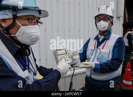 Okuma, Fukushima, Japan. 22nd Jan, 2020. Workers of Tokyo Electric Power Company (TEPCO) Fukushima Daiichi Nuclear Power Plant demonstrate to measure radiation of water processed in ALPS(Multi-nuclide retrieval equipment) II in front of the ALPS II building at the tsunami-devastated nuclear power plant in Okuma town, Fukushima Prefecture, 22 January 2020. The storage tanks including water processed in the ALPS will be full around summer of 2022, TEPCO has told. Japanese government will need to decide soon how manage the processed water still including tritium. (Credit Image: © Kimimasa May - Stock Photo