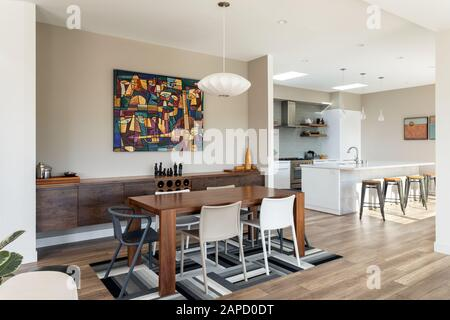 View into modern dining room and kitchen - Stock Photo