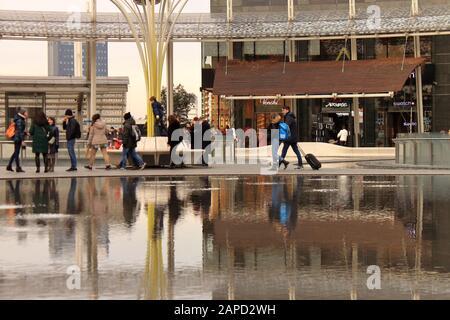 Tourists in Porta Nuova shopping center, Milan. - Stock Photo