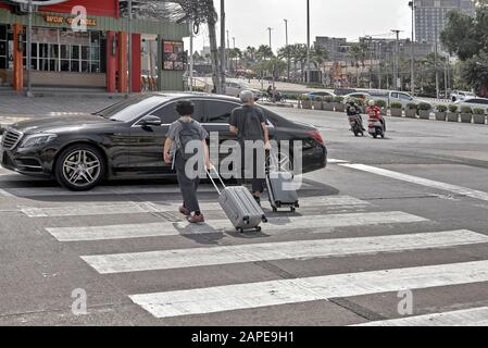 People using the pedestrian crossing with motorist ignoring their right of way which is common amongst Thai motorists. Thailand Southeast Asia - Stock Photo