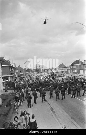 Demonstration of Belgian farmers with tractors on the road of the Netherlands Description: Belgian Rijkswacht blocks the road, above it a helicopter Date: 19 March 1971 Location: Belgium Keywords: demonstrations, farmers, helicopters, police officers, tractors - Stock Photo