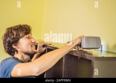 Frustrated Man Putting Together Self Assembly Furniture - Stock Photo