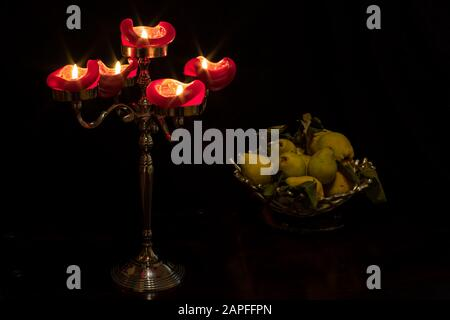 Still life with a Candelabra and a fruit basket. - Stock Photo