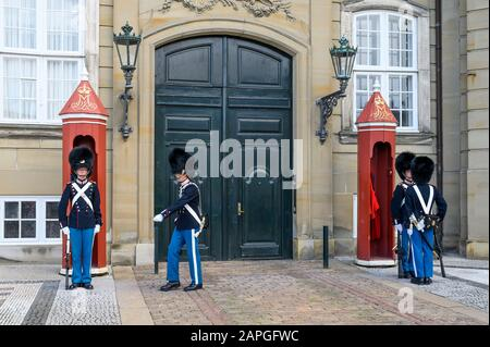 Tourists watch Changing of the Guard at the Royal Amalienborg Palace, Copenhagen, Denmark - Stock Photo
