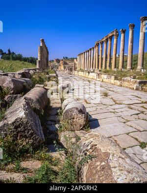 Jordan. Colonnades on the once main street of the ancient Roman City of Jerash not far from the Jordan capital city of Amman in the Middle East - Stock Photo