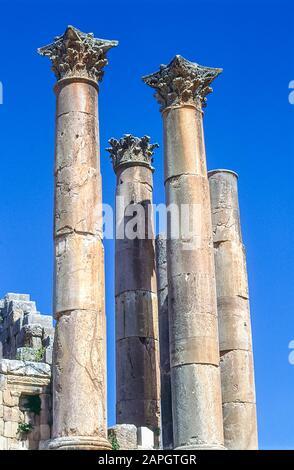 Jordan. Free standing stone columns is all that remains at the the ancient Roman City of Jerash not far from the Jordan capital city of Amman in the Middle East - Stock Photo