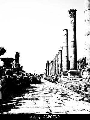 Jordan. Colonnades in stark monochrome on the once main street of the ancient Roman City of Jerash not far from the Jordan capital city of Amman in the Middle East - Stock Photo