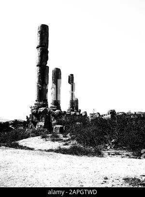 Jordan. Free standing stone columns in stark monochrome is all that remains of the ancient Roman City of Jerash not far from the Jordan capital city of Amman in the Middle East - Stock Photo