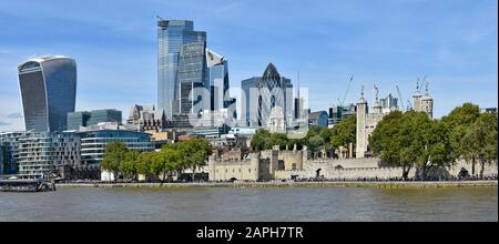 Panoramic 2019 City of London urban landscape skyline cityscape of Square Mile financial district landmark skyscraper dwarfs historic Tower of London - Stock Photo