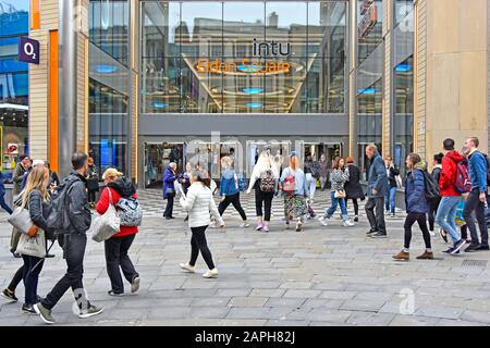 People shoppers street scene outside entrance to intu Eldon Square Shopping Centre & malls busy  Northumberland Street Newcastle Upon Tyne England UK - Stock Photo