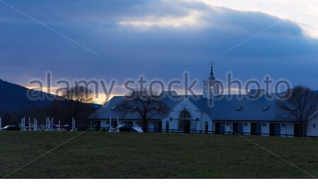 Sun setting during blue hour behind landmark stables in the Blue Ridge Mountains near Charlottesville, Virginia during winter. - Stock Photo