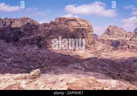 Jordan. Rugged mountain landscape overlook at the World famous UNESCO World Heritage Site of the Nabatean and Roman  ruins and relics at the desert town of Petra much used as a motion picture film set such as Indiana Jones Temple of Doom, now a very popular tourist attraction - Stock Photo