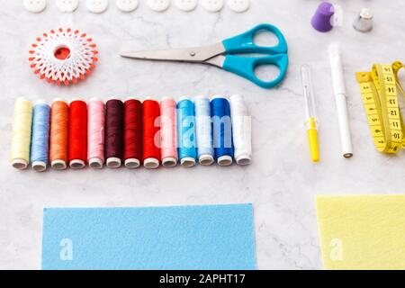 colorful sewing and tailoring tools and items on light background