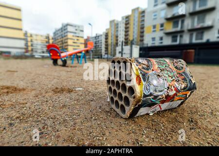 Fireworks waste litter after new years eve in the playground - Stock Photo