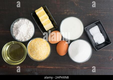 Southern Buttermilk Cornbread Ingredients: Cornmeal, eggs, and other ingredients used to make a traditional Southern dish - Stock Photo