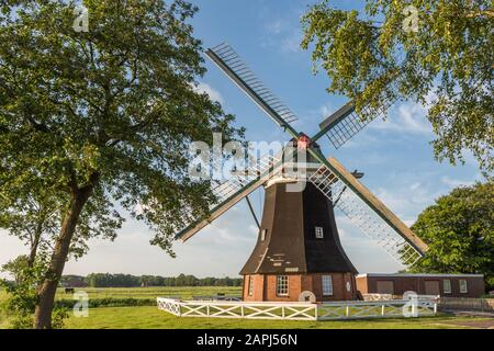 Tjadens Windmill  near the village of Grossheide in the East Frisian county of Aurich, Lower Saxony, Germany - Stock Photo