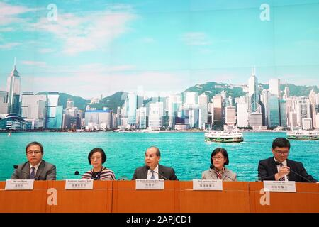 Hong Kong, China. 23rd Jan 2020. Acting Chief Executive of the Hong Kong Special Administrative Region (HKSAR) Matthew Cheung (C) speaks at a press conference in Hong Kong, south China, Jan. 23, 2020. Hong Kong confirmed two cases of novel coronavirus pneumonia on Thursday for the first time after the infectious disease broke out in central China's Wuhan city. Matthew Cheung announced strengthened control measures in the high-speed railway station at a press conference in the evening. Credit: Xinhua/Alamy Live News - Stock Photo