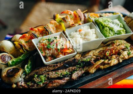 A variety of dishes on a ONE PLATE. Restaurant serving. Top view. mexican food. - Stock Photo