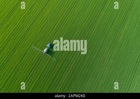 Aerial view of crop Sprayer in green agricultural field. Saale-Orla-Kreis, Thuringia, Germany, Europe. - Stock Photo