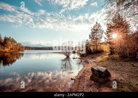 View of Forstsee at sunset, Carinthia, Austria - Stock Photo