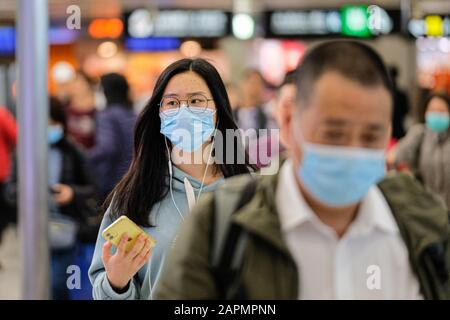 Hong Kong, China. 23rd Jan, 2020. Travellers wear masks at the departure hall of the West Kowloon Rail station. Hong Kong is in high alert as the coronavirus outbreak killed 17 people in China so far, travellers are being cautious and many put on surgical mask as they travel. Credit: Keith Tsuji/ZUMA Wire/Alamy Live News - Stock Photo