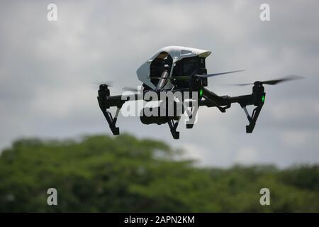 SAN SALVADOR, EL SALVADOR - Jan 13, 2020: A dji inspire 1 drone flying above some trees - Stock Photo