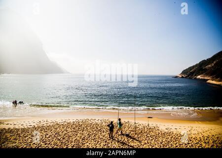 Beautiful beach and people fishing in Brazil Urca Rio De Janeiro - Stock Photo