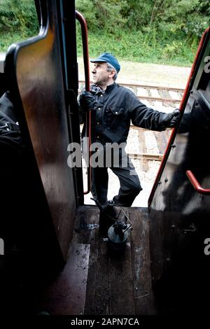 Most na Soči, Slovenia, October 4, 2008: An engine driver climbs aboard a 1944 Henschel & Son German steam engine that is pulling an old museum train on the Bohinj railway line (Transalpina) built from 1900 to 1906 as the shortest connection of the Austro-Hungarian Empire with the Adriatic Sea in Trieste (Italy). - Stock Photo
