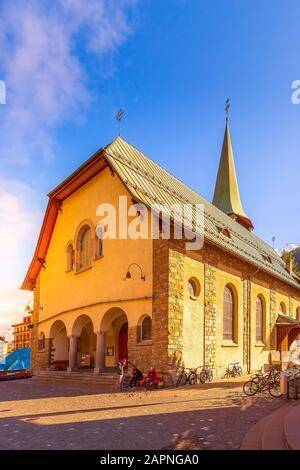 Zermatt, Switzerland - October 7, 2019: Town street view with St. Mauritius Church in famous swiss ski resort