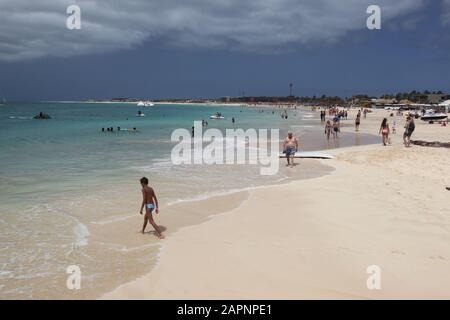 Various activities on the beach, with white sands and clear waters on  Santa Maria, Sal, Cape Verde - Stock Photo