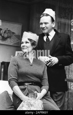 Judi Dench and Michael Williams as Barbara and Bob Jackson in PACK OF LIES by Hugh Whitemore directed by Clifford Williams at the Lyric Theatre, London in 1983. Dame Judith Olivia Dench CH DBE FRSA, born 1934. Married to the actor Michael Williams from 1971 until his death in 2001. They had one daughter, the actress Finty Williams, born in 1972. - Stock Photo