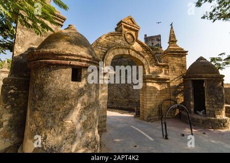 A wide angle view of the main entrance gate to the colonial architecture of the ancient Portuguese era fort in Diu Island. - Stock Photo