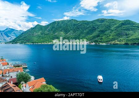 Top aerial panoramic view on old town Perast and Kotor bay on summer day in Montenegro - Stock Photo