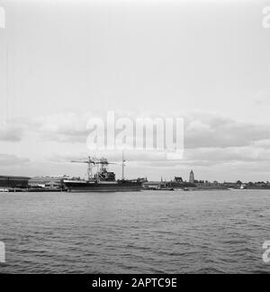 Rijnvaart, report from tug Damco 9: Netherlands  View of Gorinchem with church tower, in the background the inner harbour and in the foreground a moored ship Date: April 1, 1955 Location: Gorinchem , Zuid-Holland Keywords: ports, rivers, ships, city images - Stock Photo