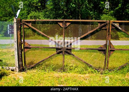 BEHRUNGEN, THURINGIA, DDR MONUMENT, GERMANY - JUNE 27, 2019 Former border fence of the inner German borders GDR to Germany at Behrungen - Stock Photo