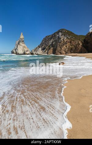 Rugged and dramatic coastline with huge boulders at the Praia da Ursa beach near Cabo da Roca, the westernmost point of mainland Europe, in Portugal.