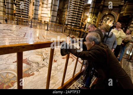 Siena, Italy, October 27, 2008 - Tourists take pictures inside the Siena Cathedral (Duomo di Siena). - Stock Photo