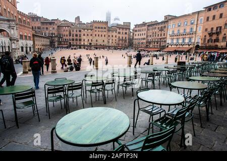 Siena, Italy, October 27, 2008: Restaurant tables and the Piazza del Campo in Siena, Italy. - Stock Photo