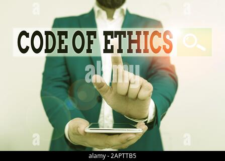 Text sign showing Code Of Ethics. Business photo text basic guide for professional conduct and imposes duties Businessman in the blue suite with lap t