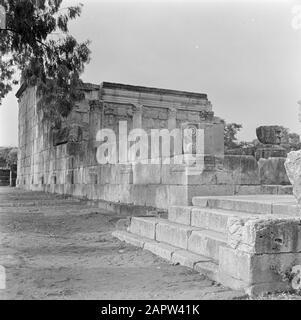 Israel 1948-1949:Galilee  Kapernaum. View of the partially reconstructed synagogue from the third century AD Date: 1948 Location: Israel, Capernaum, Tiberias Keywords: archeology, history, Jewish religion, walls, pillars, ruins, synagogues, stairs - Stock Photo