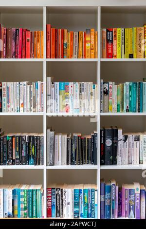 White wooden bookcase/bookshelf filled with books in a modern interior design UK home setting