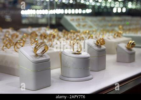 Gold rings on the counter of the store. Jewelry - Stock Photo