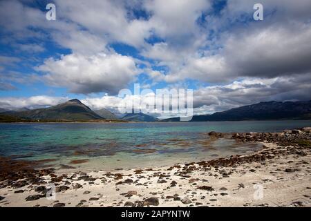 View along beautiful quiet sandy beach., Lofoten Islands, Nordland, Norway, Scandinavia - Stock Photo