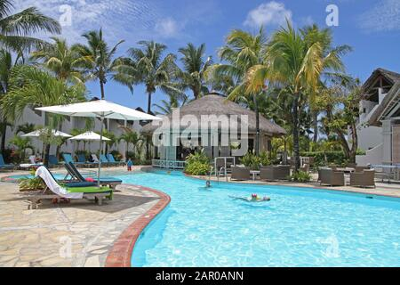 Swimming pool area in Veranda Palmar Beach Hotel and Spa, Mauritius. - Stock Photo