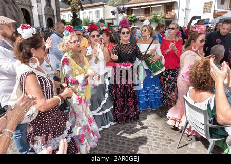 Spanish women with colorful flamenco dresses at the market of Teror, Gran Canaria - Stock Photo