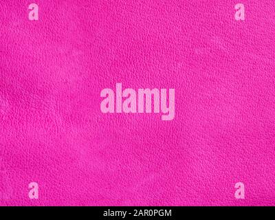 Background with leather texture. Pink piece of natural tanned calfskin painted and treated with fuchsin paint. Lots of detail, frontal shot with macro - Stock Photo