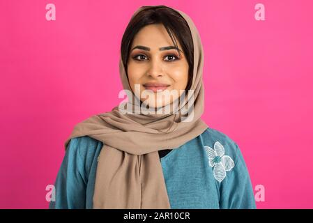 Middle eastern woman with traditional emirates dresses posing in a photographic studio - Concepts about lifestyle, happiness and family relationship i - Stock Photo